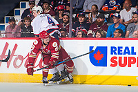 REGINA, SK - MAY 27: German Rubtsov #98 of Acadie-Bathurst Titan checks Cale Fleury #4 of Regina Pats into the boards at the Brandt Centre on May 27, 2018 in Regina, Canada. (Photo by Marissa Baecker/CHL Images)