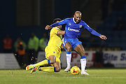 Gillingham FC Josh Parker tackled by AFC Wimbledon defender Darius Charles (32) during the EFL Sky Bet League 1 match between Gillingham and AFC Wimbledon at the MEMS Priestfield Stadium, Gillingham, England on 21 February 2017.