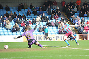 Tom Hopper of Scunthorpe United  scores goal to go 4-0 up during the Sky Bet League 1 match between Scunthorpe United and Swindon Town at Glanford Park, Scunthorpe, England on 28 March 2016. Photo by Ian Lyall.