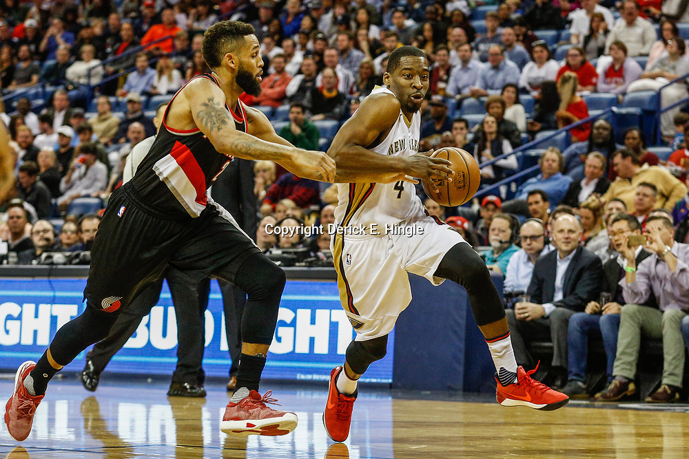 Mar 14, 2017; New Orleans, LA, USA; New Orleans Pelicans guard Jordan Crawford (4) drives past Portland Trail Blazers guard Allen Crabbe (23) during the first quarter of a game at the Smoothie King Center. Mandatory Credit: Derick E. Hingle-USA TODAY Sports