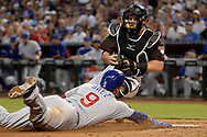 Aug 12, 2017; Phoenix, AZ, USA; Arizona Diamondbacks catcher Jeff Mathis (2) tags out Chicago Cubs infielder Javier Baez (9) in the fifth inning at Chase Field. Mandatory Credit: Jennifer Stewart-USA TODAY Sports
