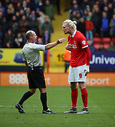 Charlton Athletic striker Simon Makienok protesting his innocence after committing a number of fouls during the Sky Bet Championship match between Charlton Athletic and Ipswich Town at The Valley, London, England on 28 November 2015. Photo by Matthew Redman.