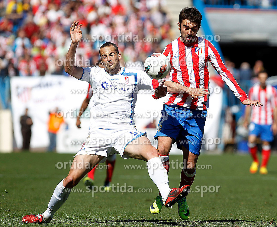 11.03.2012, Vicente Calderon Stadion, Madrid, ESP, Primera Division, Atletico Madrid vs FC Granada, 27. Spieltag, im Bild Atletico de Madrid's Adrian Lopez (r) and Granada's Borja Gomez // during La Liga match.March 11,2012 during the football match of spanish 'primera divison' league, 27th round, between Atletico Madrid and FC Granada at Vicente Calderon stadium, Madrid, Spain on 2012/03/11. EXPA Pictures © 2012, PhotoCredit: EXPA/ Alterphotos/ Acero..***** ATTENTION - OUT OF ESP and SUI *****