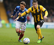 Portsmouth defender Danny East and Shrewsbury Town striker Bobby Grant compete during the Sky Bet League 2 match between Portsmouth and Shrewsbury Town at Fratton Park, Portsmouth, England on 28 March 2015.