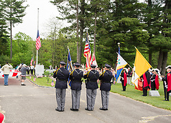 The Gilford Police Department Honor Guard pays respect as the Stars and Stripes are raised to half mast during Memorial Day ceremonies on Monday, May 29, 2017.  (Alan MacRae for the Laconia Daily Sun)