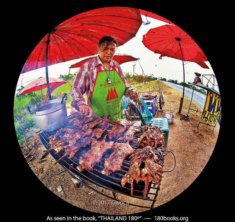 A woman sells BBQ voles at a roadside stand in Chainat, Thailand.