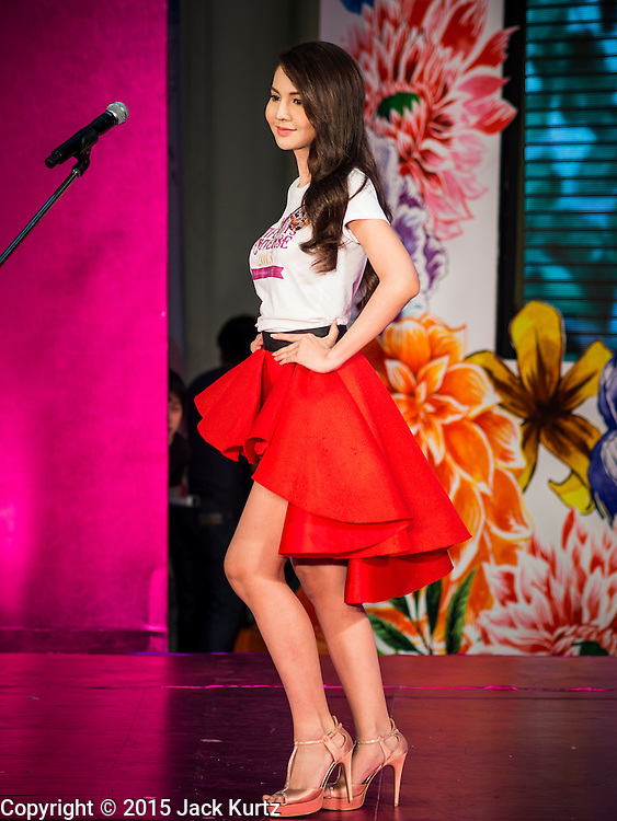 25 MARCH 2015 - BANGKOK, THAILAND: A contestant walks across the stage in the first round of the Miss Tiffany's contest at CentralWorld, a large shopping mall in Bangkok. Miss Tiffany's Universe is a beauty contest for transgender contestants; all of the contestants were born biologically male. The final round will be held on May 8 in the beach resort of Pattaya. The final round is televised of the  Miss Tiffany's Universe contest is broadcast live on Thai television with an average of 15 million viewers.     PHOTO BY JACK KURTZ