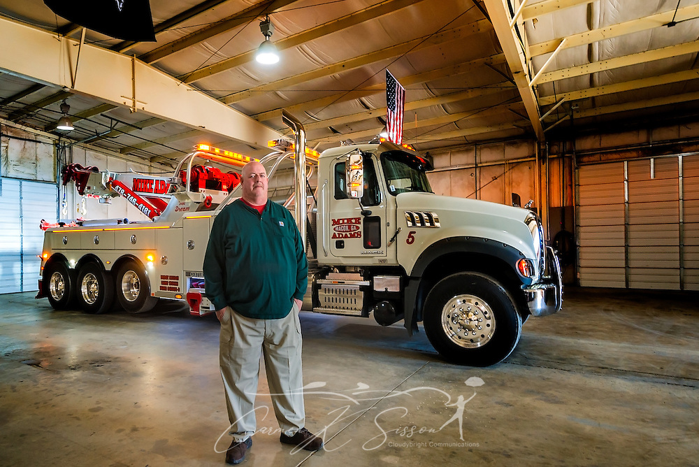 Mike Adams, of Mike Adams Towing and Air Cushion Recovery, is pictured with his newest truck, a 2016 Mack Granite with a 50-ton Century rotator, March 22, 2016, in Macon, Georgia. Adams started his business with a 1993 with a 1989 Mack Super-Liner. Today, he owns 27 towing and recovery trucks, nearly a third of which are Macks. (Photo by Carmen K. Sisson/Cloudybright)