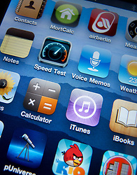 Close-up of screen of iPhone 4G smart phone showing apps
