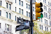 Green traffic light for GO at corner of Wall Street and Broadway in New York, USA