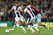 West Bromwich Albion midfielder (on loan from Fulham) Stefan Johansen (6) fouls Aston Villa midfielder Jack Grealish (10) as West Bromwich Albion defender Craig Dawson (25) comes in to help during the EFL Sky Bet Championship play-off second leg match between West Bromwich Albion and Aston Villa at The Hawthorns, West Bromwich, England on 14 May 2019.