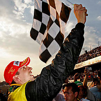 4-6 November, 2005, Mexico City, Mexico.<br /> Justin Wilson waves the checkered flag.<br /> &copy; 2005 Phillip Abbott/USA<br /> LAT Photographic