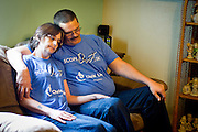 NORTH FREEDOM — October 6, 2014: SaDonna Oakley, left, rests on the couch with her husband, Joe, in their North Freedom trailer park home. Oakley was diagnosed with Stage IV colon cancer in May 2014 and went into surgery early morning on Tuesday, October 7 at St Mary's Hospital in Madison.