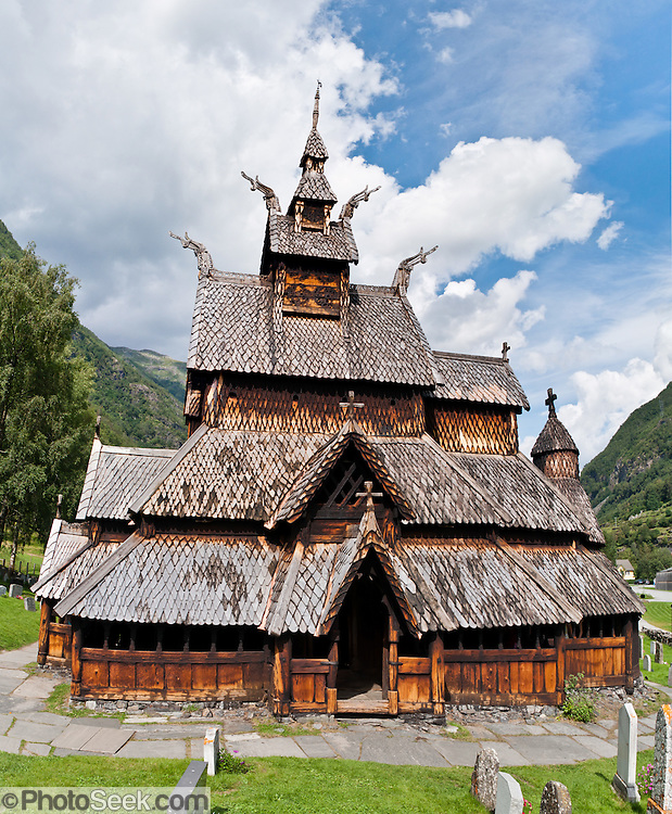 "The 12th century Borgund Stave Church (stavkirke or stavkyrkje) is the best preserved of Norway's 28 remaining stave churches. ""Staves"" are upright logs that support the central room framework. Borgund is a triple nave stave church of the Sogn-type. Location: Borgund, Lærdal municipality, Sogn og Fjordane county, Norway. Panorama stitched from 3 overlapping photos."