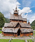 """The 12th century Borgund Stave Church (stavkirke or stavkyrkje) is the best preserved of Norway's 28 remaining stave churches. """"Staves"""" are upright logs that support the central room framework. Borgund is a triple nave stave church of the Sogn-type. Location: Borgund, Lærdal municipality, Sogn og Fjordane county, Norway. Panorama stitched from 3 overlapping photos."""
