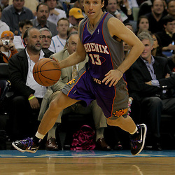 Nov 19, 2009; New Orleans, LA, USA;  Phoenix Suns guard Steve Nash (13) drives with the ball against the New Orleans Hornets during the second half at the New Orleans Arena. The Hornets defeated the Suns 110-103. Mandatory Credit: Derick E. Hingle-US PRESSWIRE