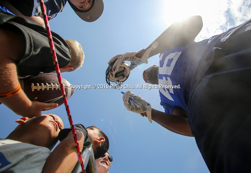 Los Angeles Rams' Cory Harkey signs autographs for fans before the start of training session at UC Irvine campus.<br /> (Photo by Ringo Chiu/PHOTOFORMULA.com)<br /> <br /> Usage Notes: This content is intended for editorial use only. For other uses, additional clearances may be required.