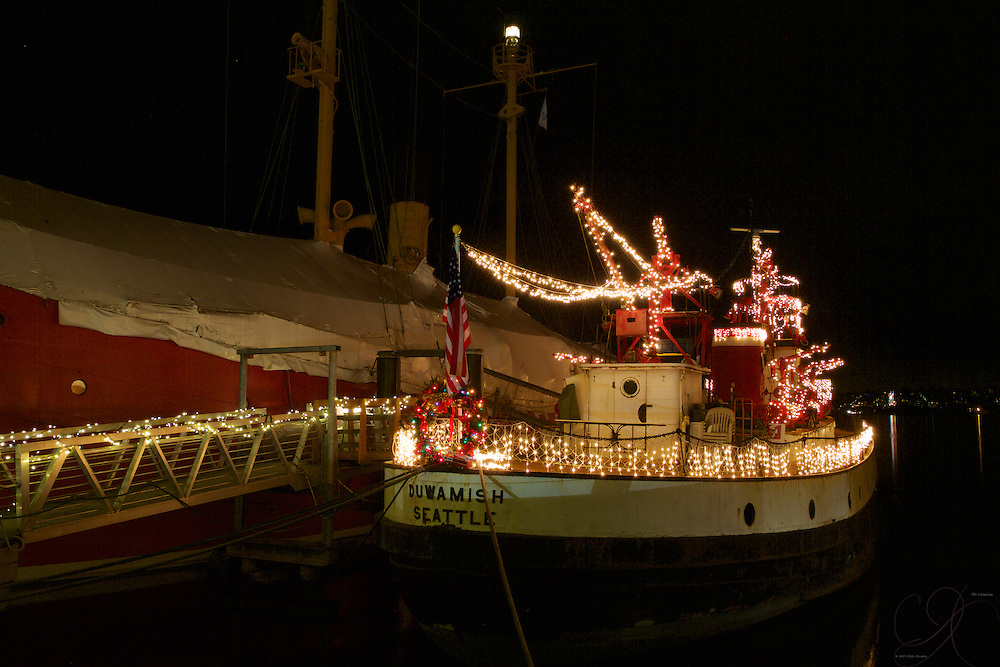 The Duwamish Fireboat dressed up for the holidays (1909) docked at the Historic Ships Wharf at S. Lake Union.