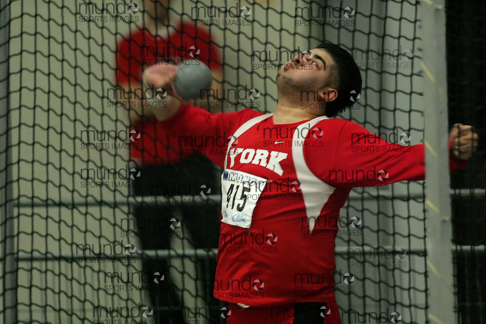 (Windsor, Ontario---13 March 2010) Umar Khan of York University Yoemen   competes in the men's shot put at the 2010 Canadian Interuniversity Sport Track and Field Championships at the St. Denis Center. Photograph copyright Sean Burges/Mundo Sport Images. www.mundosportimages.com