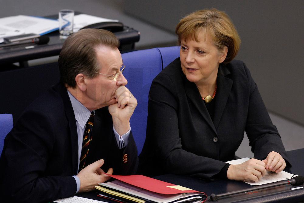 09 FEB 2006, BERLIN/GERMANY:<br /> Franz Muentefering (L), SPD, Bundesarbeitsminister, und Angela Merkel (R), CDU, Bundeskanzlerin, im Gespraech, vor Beginn einer aktuelle Stunde zur Erhoehung des Renteneintrittsalters auf 67 Jahre, Plenum, Deutscher Bundestag<br /> IMAGE: 20060209-02-040<br /> KEYWORDS: Franz M&uuml;ntefering, Gespr&auml;ch
