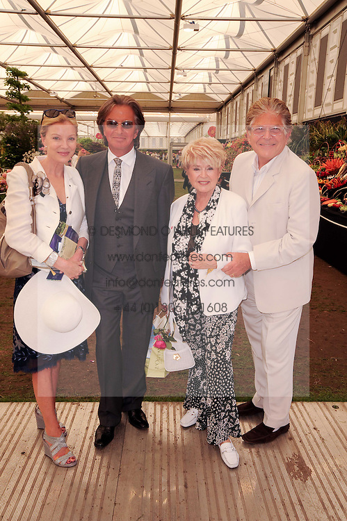 Th 2010 Royal Horticultural Society Chelsea Flower show in the grounds of Royal Hospital Chelsea, London on 24th May 2010.<br /> <br /> Picture shows:-Left to right, RICHARD CARING, his wife JACKIE, GLORIA HUNNIFORD and her husband STEPHEN WAY
