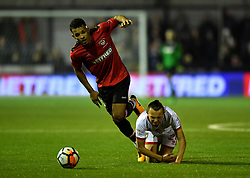 "Hyde FC's Kyle Harrison (left) and MK Dons' Aidan Nesbitt battle for the ball during the Emirates FA Cup, first round match at Ewen Fields, Hyde. PRESS ASSOCIATION Photo. Picture date: Friday November 3, 2017. See PA story SOCCER Hyde. Photo credit should read: Anthony Devlin/PA Wire. RESTRICTIONS: EDITORIAL USE ONLY No use with unauthorised audio, video, data, fixture lists, club/league logos or ""live"" services. Online in-match use limited to 75 images, no video emulation. No use in betting, games or single club/league/player publications."
