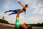Acro Yoga with bats leaving Congress Street Bridge.<br />