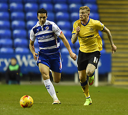 Reading's Stephen Kelly and Wigan Athletic's James McClean chase the ball - Photo mandatory by-line: Paul Knight/JMP - Mobile: 07966 386802 - 17/02/2015 - SPORT - Football - Reading - Madejski Stadium - Reading v Wigan Athletic - Sky Bet Championship
