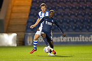 southend united forward Theo Robinson Colchester United defender Thomas Eastman (18) battles for possession during the EFL Trophy match between Colchester United and Southend United at the Weston Homes Community Stadium, Colchester, England on 9 October 2018.
