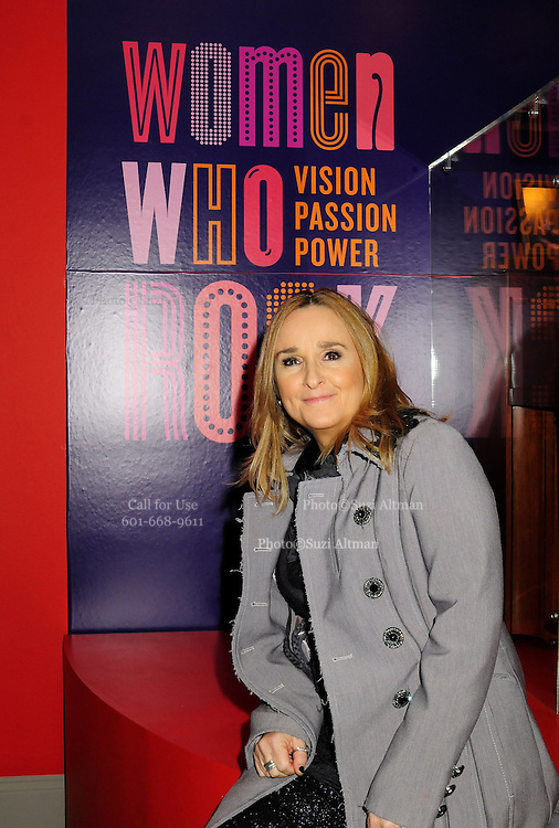 """Melissa Etheridge poses for a photo in front Etheridges' jacket she wore to the 2005 Grammy Award show. The jacket is part of the """"Women Who Rock"""" exhibition sponsored by the Rock and Roll Hall of Fame and the RIAA (Recording Industry Association of America) at NMWA in Washington DC. Sunday Nov. 4th. Grammy award winner Melissa Etheridge is presented with The Excellence in the Performing Arts award from the National Museum of Women in the Arts (NMWA) in Washington DC. Sunday Nov. 4, 2012. Etheridge  also performed on the piano and then an acoustic set on guitar for an intimate audience of about 400 people. Photo ©Suzi Altman/For NMWA Grammy award winner Melissa Etheridge is presented with the National Museum of Women in the Arts' (NMWA) Award for Excellence in the Performing Arts in Washington DC. Sunday Nov. 4, 2012. Etheridge also performed on the piano and then an acoustic set on guitar for an intimate audience of about 300 people. Photo ©Suzi Altman/For NMWA<br /> <br /> Melissa Etheridge NMWA Award for Excellence in the Performing Arts"""