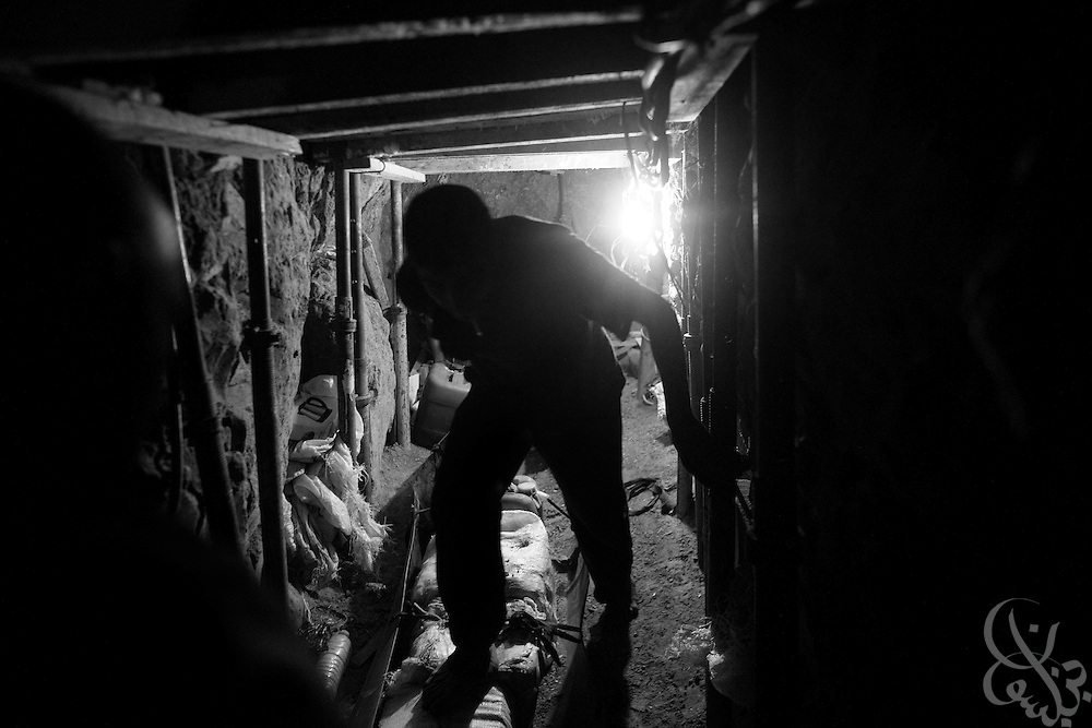 A Palestinian smuggler moves construction supplies including nails and cement through an illegal tunnel under the Gaza-Egyptian border December 22, 2009 in Rafah, Gaza. Despite the 22 day Israeli offensive last year in Gaza, tunnels have proliferated to the point where the vast supply of goods has exceeded demand, causing prices to dramatically fall and tunnel profits to plummet. .