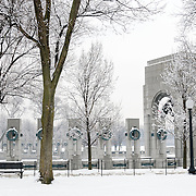 A snow-covered World War Two Memorial on the National Mall in Washington DC.