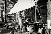 An Indian chef working at a roadside fast food business, Varanasi (Benares), India.