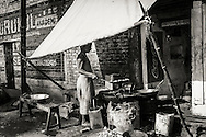 An Indian chef working at a roadside fast food business, Varanasi (Benares), India.