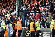 Notts County fans celebrates a goal from Notts County forward Jonathan Stead (30) (score 2-3) during the EFL Sky Bet League 2 match between Leyton Orient and Notts County at the Matchroom Stadium, London, England on 18 February 2017. Photo by Andy Walter.