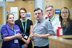 © Licensed to London News Pictures. 26/01/2018. Lancaster, UK. Shadow Health Secretary JONATHAN ASHWORTH MP (centre, pictured in the A&E department) and Lancaster and Fleetwood MP CAT SMITH (r) visit Lancaster Royal Infirmary and tour Accident and Emergency and the wards on a day when the A&E department at the hospital was at 100% of capacity with no spare cubicles . Labour say the NHS is in crisis in the North West with patients waiting in ambulances outside hospitals for over an hour and hospitals running out of beds. Photo credit: Joel Goodman/LNP