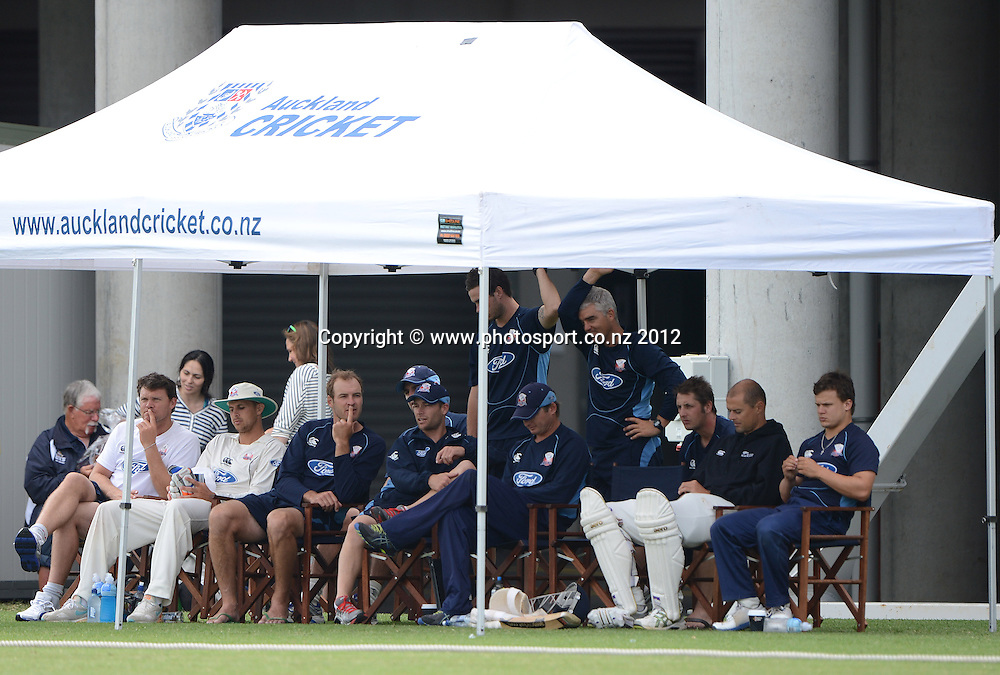 Auckland players and management. Plunket Shield Cricket, Auckland Aces v Canterbury Wizards at Eden Park Outer Oval. Auckland on Tuesday 18 December 2012. Photo: Andrew Cornaga/Photosport.co.nz