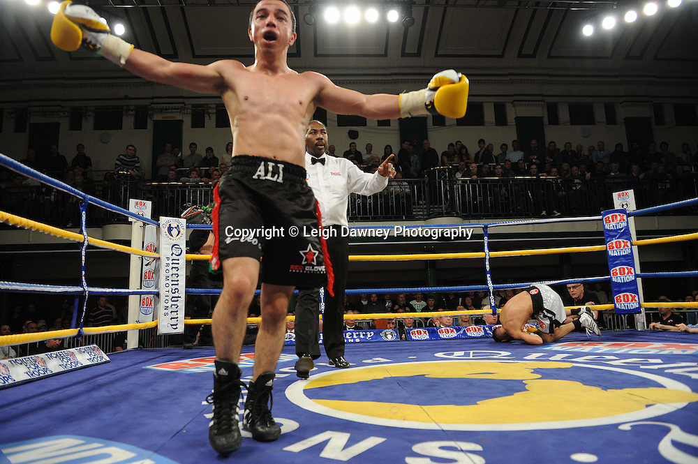 Najah Ali knocks down Michael McGuire in a 6x3 min Super Bantamweight contest at York Hall, Bethnal Green, London on Friday 13th January 2012. Queensbury Promotions © Leigh Dawney 2012
