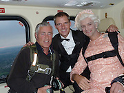 'Secret agent' in the coup that made the Queen a global TV comedy star... and the daredevil who took a Royal dive<br /> <br /> Few women would pass up the chance of being whisked away in a helicopter by 007 star Daniel Craig – even the Queen could not resist such an invitation.<br /> A great-grandmother and octogenarian, she is probably too mature now to be called a Bond girl.<br /> But when the secret agent from the movies called on the Palace to ask her to accompany him on a special mission, she had no hesitation in accepting.<br /> <br /> The result was the most talked-about sequence of Danny Boyle's stunning Olympics Opening Ceremony. <br /> In the segment, prerecorded at Buckingham Palace, the Queen receives the 007 star with the words: 'Good evening, Mr Bond.'<br /> They then leave and walk towards a helicopter, corgis in tow, and at one point Craig gives a nuanced glance in Her Majesty's direction.<br /> It was the Queen's first film role, but it was revealed yesterday that she needed only one take.<br /> 'She's a good actor,' said Mr Boyle last night. <br /> 'She's very sharp. You didn't have to tell her anything twice.' Not only that, he added, but she also 'got along with James Bond very well'.<br /> It was all the irrepressible Mr Boyle's idea. He raised it with London 2012 chief Sebastian Coe, who thought it inspired.<br /> If Lord Coe was a little doubtful, however, that it would be well received by the Queen's courtiers, he was quickly reassured. <br /> They listened sagely, laughed, and promised to ask the Boss.<br /> <br /> Photo Shows: Gary Connery, right, the skydiving 'Queen' prepares for his dramatic arrival at the Olympics opening ceremony on Friday night pictured with James Bond double Mark Sutton, middle, in the helicopter en route to the stadium<br /> Picture by Gary Connery/Exclusivepix