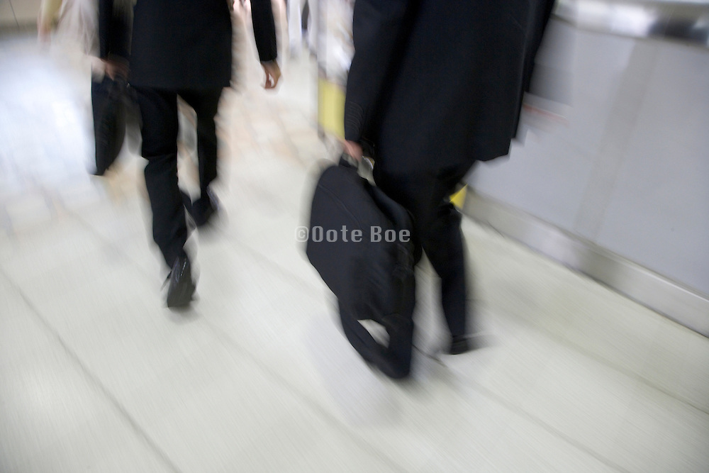businessmen hurrying on there way to work