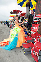 31/07/2014 Repro Free Iloma Zalewska Belfast putting a bet on the Anthony Ryans Best Dressed Ladies day  at the Galway Races Summer Festival <br />  .Photo:Andrew Downes