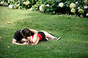 Young couple kissing in a park.