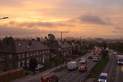 Acton, London, September 28th 2016. Traffic on the A40 rumbles into the capital with distant skyscrapers in the city appearing through the haze as a new day dawns in London.