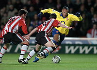 Photo: Richard Lane.<br />Southampton v Arsenal. Barclaycard Premiership.<br />29/12/2003.<br />Thierry Henry breaks past Chris Baird and Rory Delap.