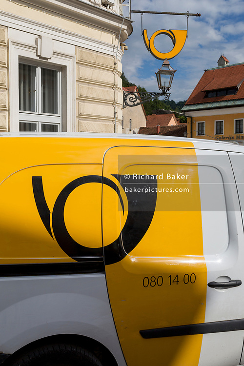 A van and logo from the Slovenian postal service (Posta Slovenije) outside the post office in rural Slovenia, on 26th June 2018, in Kamnik, Slovenia.