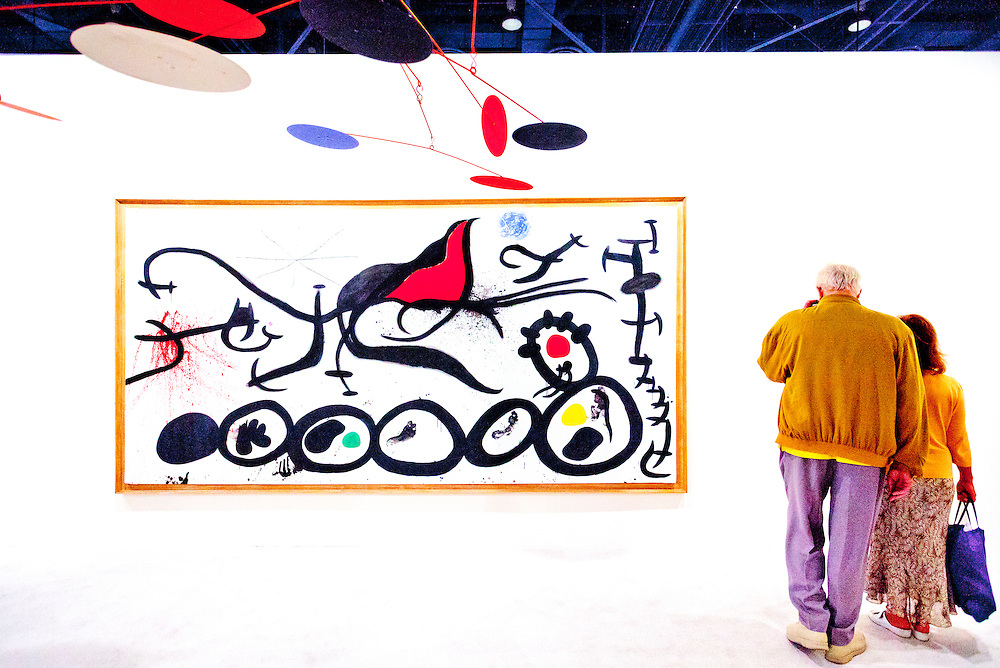 Painting by Joan Mir&oacute; entitled &quot;La March Penible Guidee Par L'Osieau Flamboyant Du Desert&quot; at Art Basel Miami Beach 2010.<br /> <br /> The mobile scupture hanging from above is by Alexander Calder