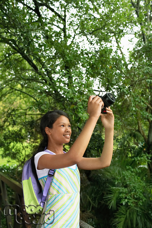 Girl Taking Photographs