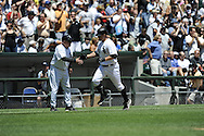 CHICAGO - JULY 23:  Jim Thome #25 of the Chicago White Sox celebrates with third base coach Jeff Cox after hitting a first inning home run during the game against the Texas Rangers at U.S. Cellular Field in Chicago, Illinois on July 23, 2008.  The White Sox defeated the Rangers 10-8.  (Photo by Ron Vesely)