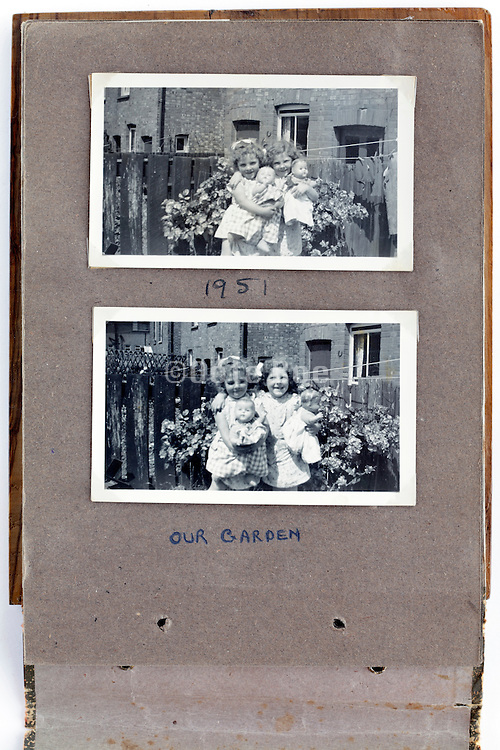 album page with two little girls having fun posing