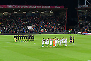 A minutes silence for Leicester City chairman Vichai Srivaddhanaprabha and the other crew and passengers who died in the helicopter crash on Saturday before the EFL Cup 4th round match between Bournemouth and Norwich City at the Vitality Stadium, Bournemouth, England on 30 October 2018.